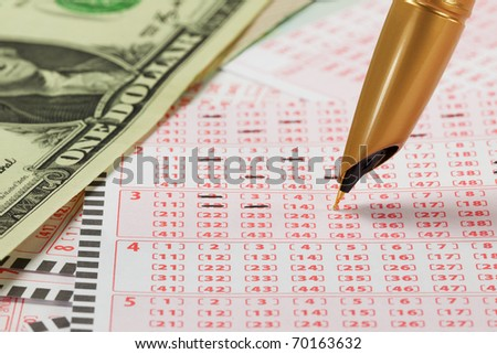 Closeup of lottery ticket and pen. - stock photo