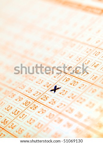 Closeup of lottery ticket with a marked number... - stock photo