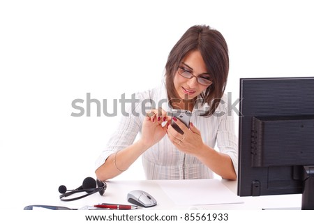 Closeup of lovely young business woman text messaging on mobile phone
