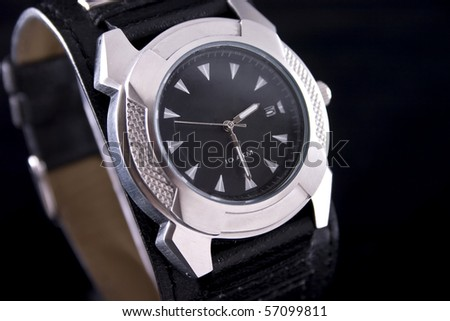 Closeup of luxury chronography watch on black background - stock photo