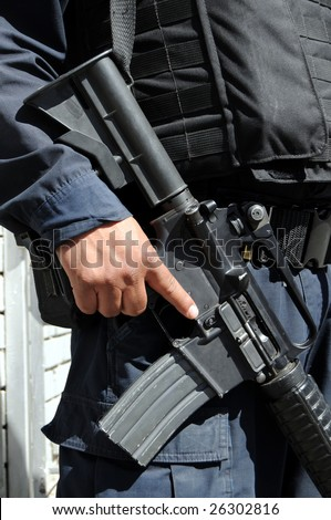 Closeup of M4 carbine / assault rifle held by a special forces soldier on the Mexican side of the US-Mexico border - stock photo