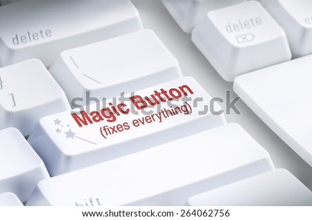 Closeup of Magic Button on computer keyboard which claims to Fix Everything; represents IT support, computer problems, fixes, solutions, lost files, program crashes, internet connection; fixes it all! - stock photo