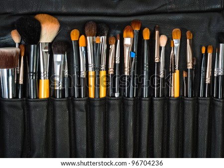 Closeup of makeup tools in their holder - stock photo