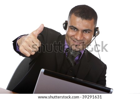 Closeup of male call center agent expressing positivity by showing thumb up - stock photo