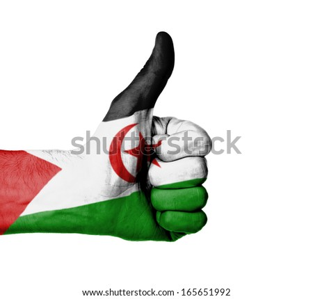 Closeup of male hand showing thumbs up sign, flag of Western Sahara - stock photo