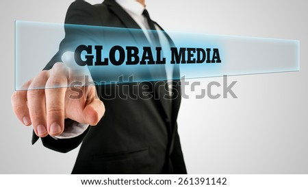 Closeup of male hand touching a Global media button on virtual screen. - stock photo