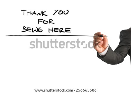 Closeup of male hand writing a Thank you for being here note on a white virtual screen. Conceptual of care and support for someone in need. - stock photo