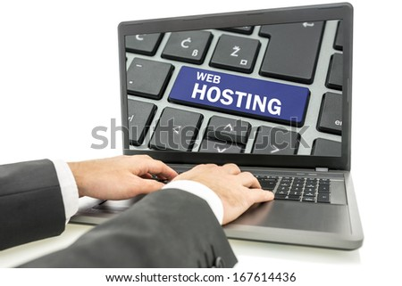 Closeup of male hands working on laptop computer with web hosting button on its screen. - stock photo