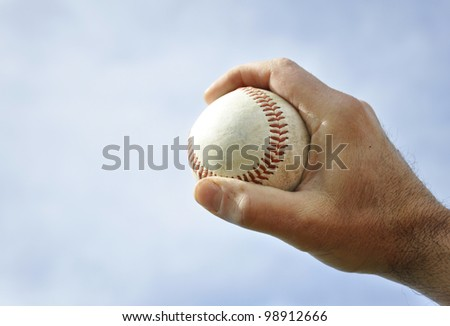 closeup of male right hand holding a baseball - stock photo