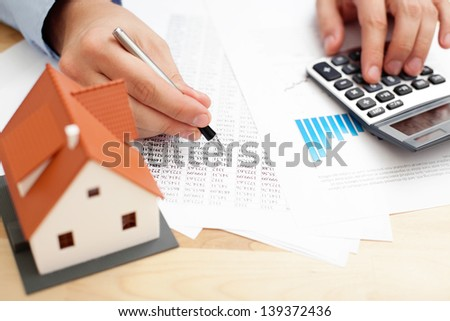 Closeup of man counting payments for home - stock photo