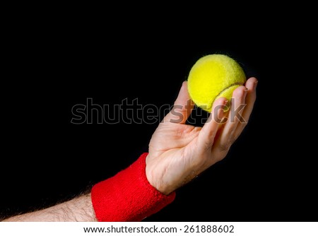 Closeup of man hand, arm, preparing to toss the tennis ball, performing the serve. Preparation for serve. Tennis player, competition. Isolated on black.