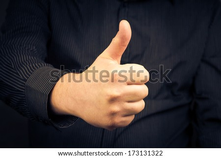 Closeup of man hand showing thumbs up