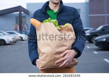 closeup of man hoplding a shopping bag - stock photo