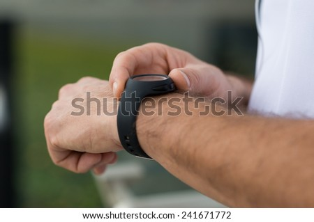 Closeup Of Man Measuring Pulse After Running - stock photo