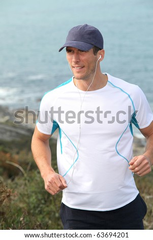 Closeup of man running outside - stock photo