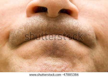 Closeup of man's face with clenched lips - stock photo