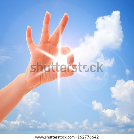 Closeup of man's hand gesturing - showing sign ok (okay) Ok in sky. - stock photo