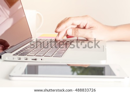 Closeup of man's hand working with laptop, selective focus, vintage effect style
