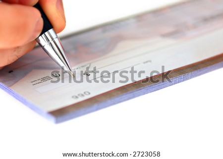 Closeup of man's hand writing a cheque - stock photo