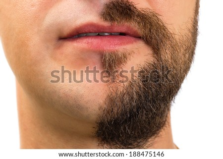 Closeup of man with  beard on half of the face on white background
