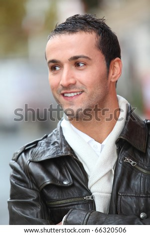 Closeup of man with leather jacket standing outside