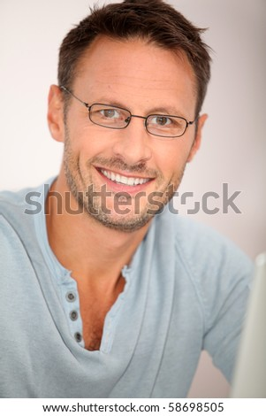 Closeup of man working at home - stock photo