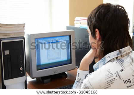 Closeup of man working on computer - face looking at monitor