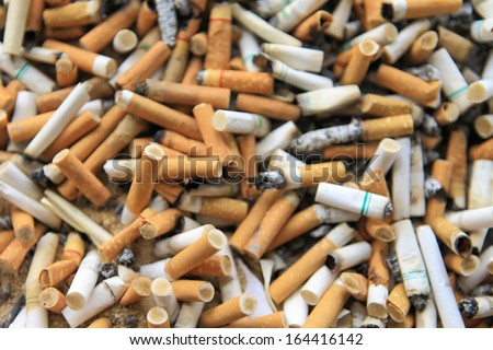 closeup of many dirty cigarettes butts background - stock photo