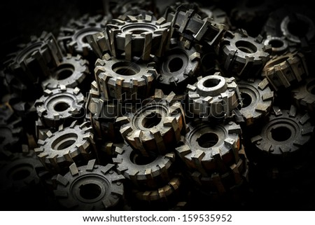 Closeup of many metal cog gears - stock photo