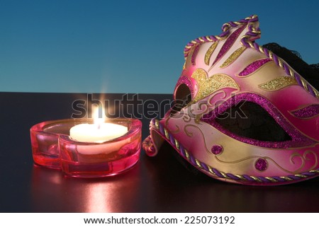 Closeup of mask with Candle. - stock photo