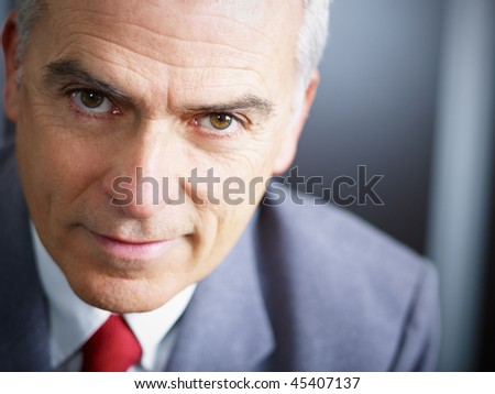 closeup of mature business man looking at camera. Copy space - stock photo