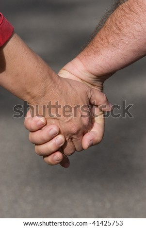 closeup of mature couple holding hands