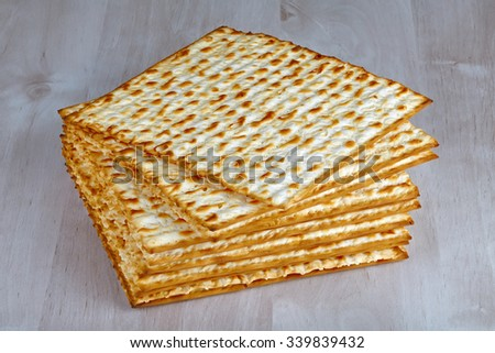 Closeup of Matzah on wooden table which is the unleavened bread served at Jewish Passover dinners  - stock photo