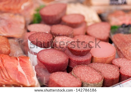 Closeup of meat in refrigerated section of supermarket - stock photo
