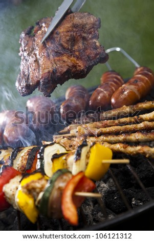 Closeup of meat on grill - stock photo