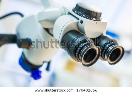 closeup of medical microscope with shallow depth of field - stock photo