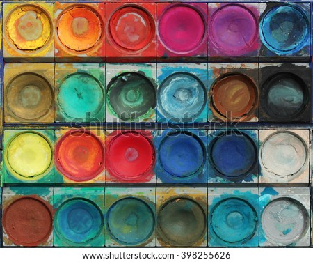 Closeup of messy, used water-color paintbox - stock photo