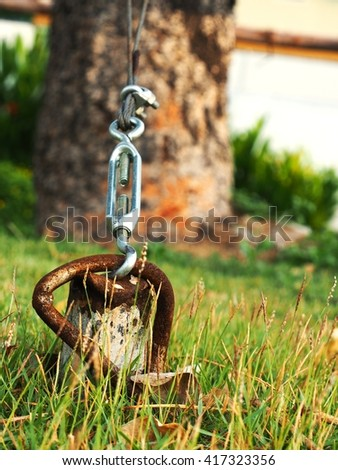 Closeup of metal fasteners and steel wire rope - stock photo