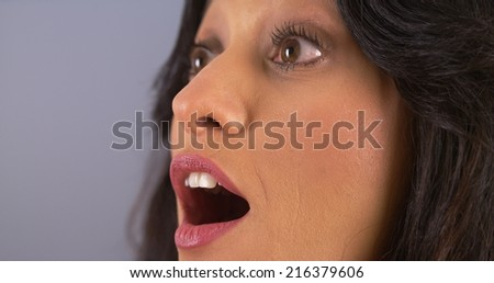 Closeup of Mexican woman surprised - stock photo