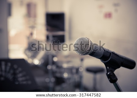 Closeup of microphone in music studio blurred background,vintage tone style