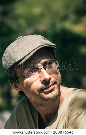 Closeup of middle aged pensive man outdoors. - stock photo