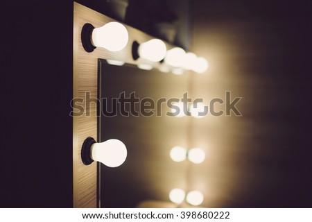 closeup of mirror bulbs at make up room - stock photo