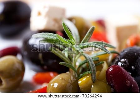 closeup of mixed antipasti with rosemary - stock photo
