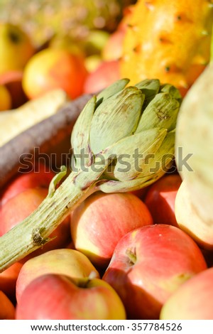Closeup of mixed exotic fruits and vegetables on farmers market stall - stock photo