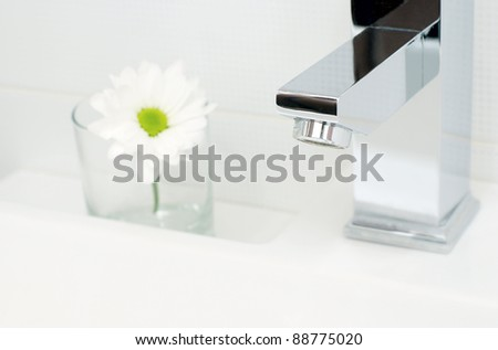 Closeup of modern bathroom tap - stock photo