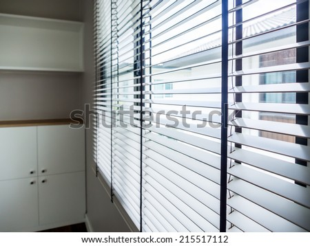 Closeup of modern interior with timber blind - stock photo