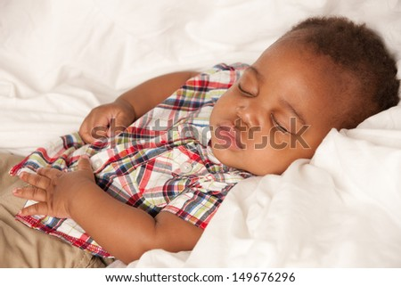 Closeup of 6 Month Old Little Baby African American Boy Sleeping in Cradle - stock photo