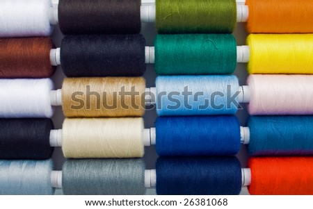 closeup of  multicolored sewing spools - stock photo