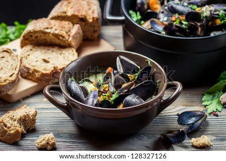Closeup of mussels and fresh vegetables served at home - stock photo