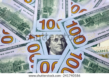 Closeup of new one hundred American dollar bills surrounding the image of Benjamin Franklin - stock photo